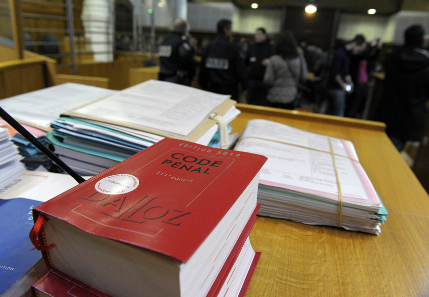 Copies of French penal code are pictured at Nimes courthouse on December 16, 2013 at the opening of Nicolas Blondiau's trial on charge of raping and kiling 8-year-old girl Oceane in November 2011 in the southeastern France village of Bellegarde. AFP PHOTO / PASCAL GUYOT PASCAL GUYOT / AFP