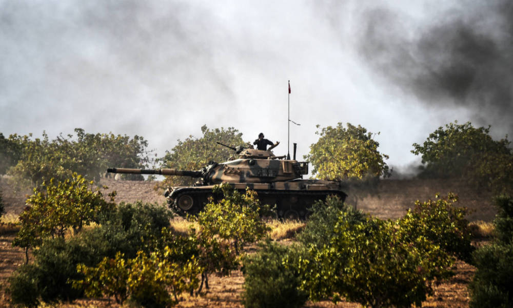 This picture taken around 5 kilometres west from the Turkish Syrian border city of Karkamis in the southern region of Gaziantep, on August 25, 2016 shows Turkish Army tanks driving to the Syrian Turkish border town of Jarabulus. Turkey's army backed by international coalition air strikes launched an operation involving fighter jets and elite ground troops to drive Islamic State jihadists out of a key Syrian border town.