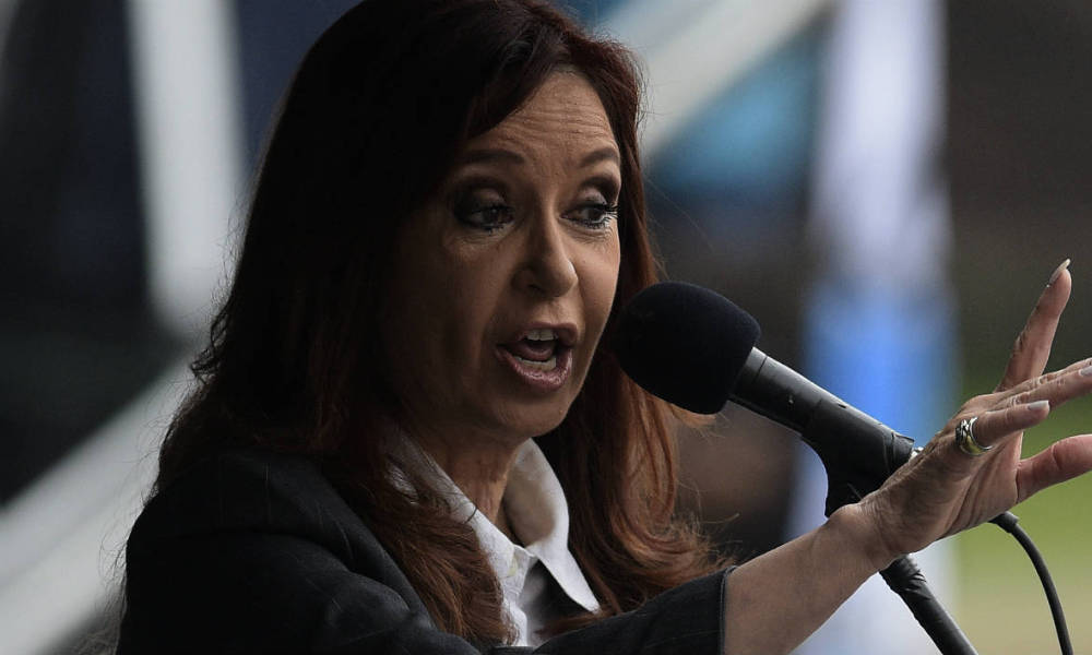 Argentine former president Cristina Fernandez de Kirchner delivers a speech before supporters gathering in front of the Comodoro Py courthouse where she testified before federal judge Claudio Bonadio over corruption allegations, in Buenos Aires on April 13, 2016. Fernandez de Kirchner testified in an investigation into whether she mishandled