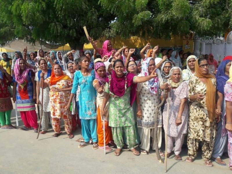 Followers of Gurmeet Ram Rahim Singh, the controversial head of religious sect Dera Sacha Sauda (DSS), gather on the roadside in Sirsa, where his organization is based, ahead of a court's verdict in a rape case against him