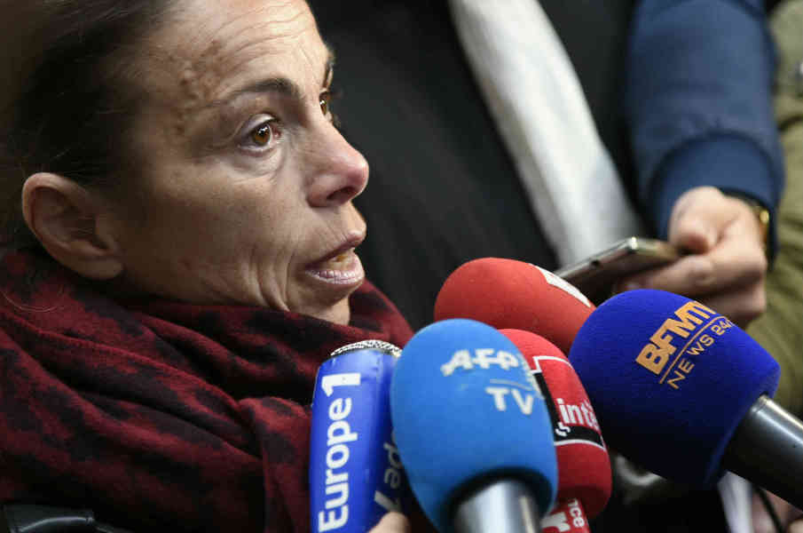 Former president of the INA (Institut National de l'Audiovisuel - National Audiovisual Institute) Agnes Saal (C-L) speaks to the press at the Creteil courthouse on April 11, 2016 after pleading guilty of public money misuse while head of INA. Agnes Saal was sentenced to pay a fine of 4,500 euros in total, 30 euros over 150 days, by the Criminal Court for excessive taxis bills.