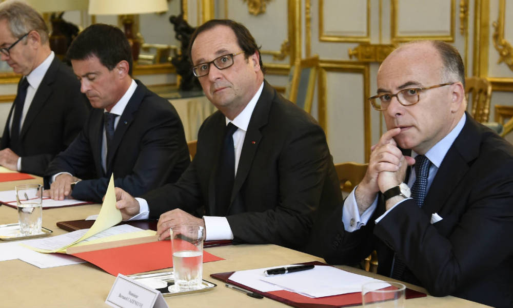 "French President Francois Hollande (2nd R), flanked by French Interior Minister Bernard Cazeneuve (R) and French Prime Minister Manuel Valls (3rd R), looks on during a meeting with French representatives of the different religions at the Elysee Presidential Palace in Paris on July 27, 2016 following yesterday attack at a church in Saint-Etienne-Du-Rouveray. France probes an attack on a church in which two men described by the Islamic State group as its ""soldiers"" slit the throat of a priest. An elderly priest had his throat slit in a church in northern France on July 26 after two men stormed the building and took hostages. The attack in the Normandy town of Saint-Etienne-du-Rouvray came as France was still coming to terms with the Bastille Day killings in Nice claimed by the Islamic State group."