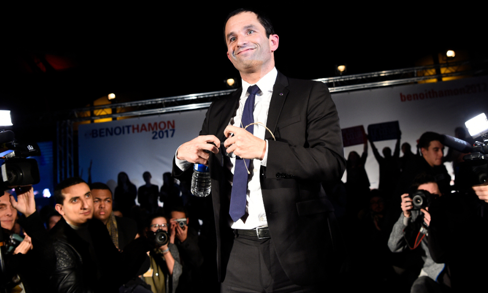 Candidate for the left-wing primaries ahead of the 2017 presidential election, Benoit Hamon smiles after delivering a speech during a campaign rally in Paris, on December 14, 2016.  bertrand GUAY / AFP