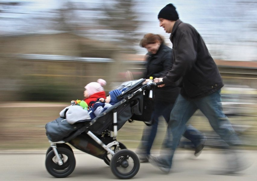 Parents push their baby in a stroller during the race walking competition in Brno, Czech Republic on April 7, 2013 , the World Health Day. The Stroller Racing World Health Day event was celebrated nationwide on 25 different locations in the Czech Republic, with competitions for mothers, fathers and the entire family. AFP PHOTO / RADEK MICA