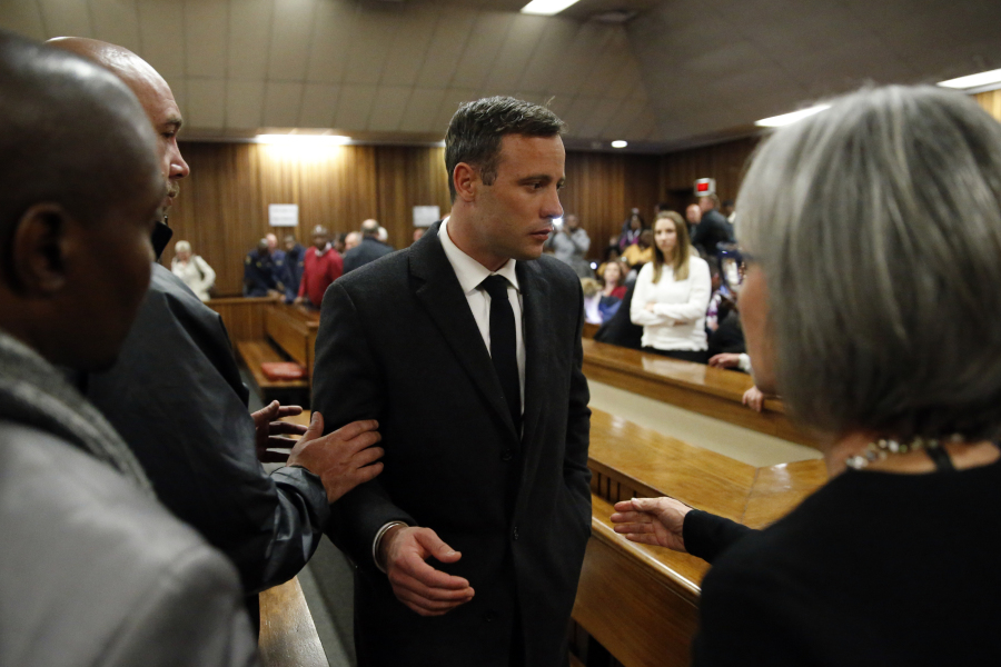 South African Paralympian athlete Oscar Pistorius (C) speaks with relatives as he leaves the High Court in Pretoria, on July 6, 2016 after being sentenced to six years in jail for murdering his girlfriend Reeva Steenkamp three years ago. Pistorius was freed from prison in the South African capital Pretoria last October after serving one year of a five-year term for culpable homicide -- the equivalent of manslaughter. MARCO LONGARI / POOL / AFP