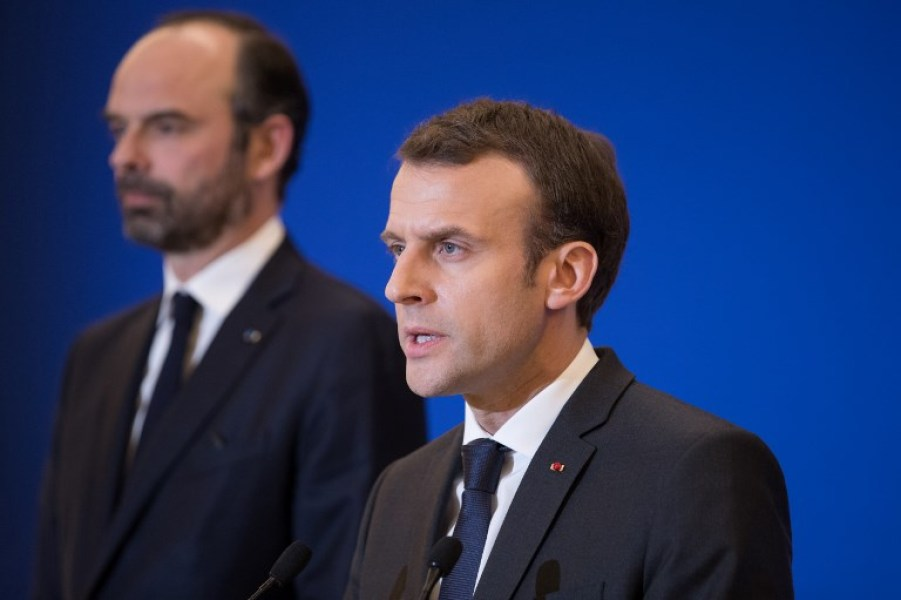 French President Emmanuel Macron delivers a speech at the Interior Minister in Paris attended by Prime Minister Edouard Philippe after a hostage situation in a supermarket in the village of Trebes, on March 23, 2018.