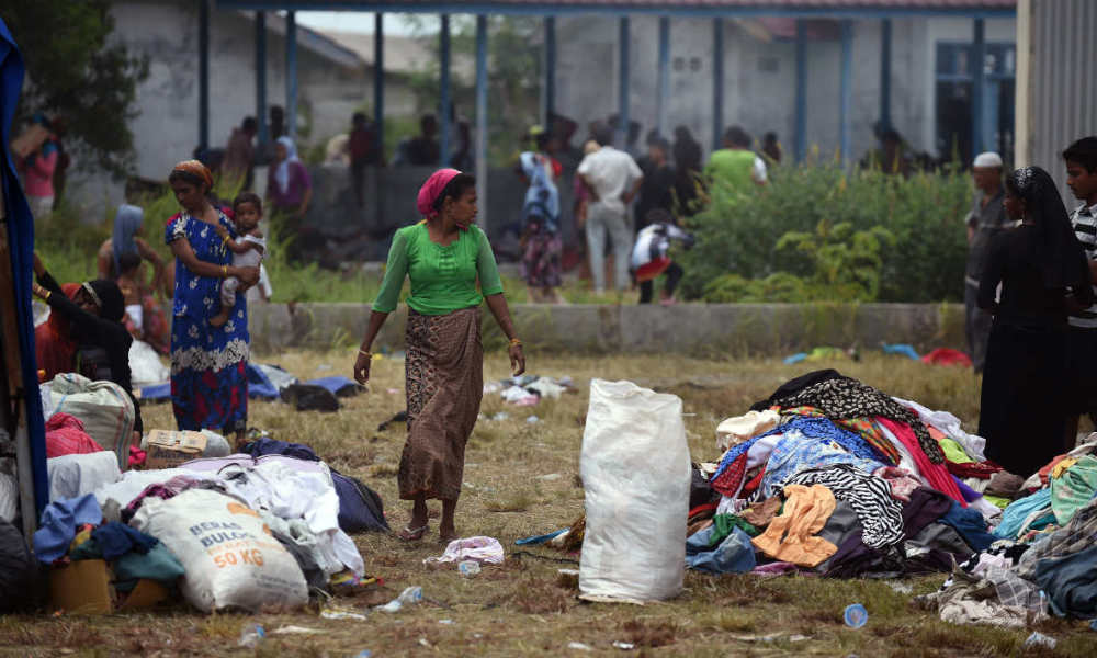Rohingyas Rohingya women search through clothes donated by residents in the new confinement area in the fishing town of Kuala Langsa in Aceh province on May 16, 2015 where hundreds of migrants from Myanmar and Bangladesh mostly Rohingyas are taking shelter after they were rescued by Indonesian fishermen. Washington raised the pressure on Southeast Asia to open its ports to boatpeople May 16 after migrants described a terrifying battle for survival between Rohingya and Bangladeshi passengers as their shunned