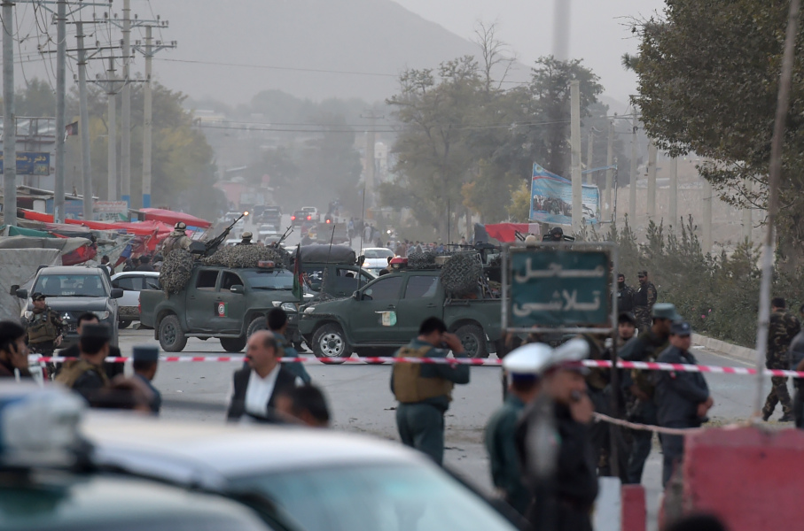 Afghan security personnel gather as they keep watch near the site of a suicide bomb attack near the Marshal Fahim military academy base in Kabul on October 21, 2017.