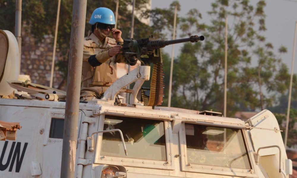 A Moroccan peacekeeper from the United Nations Mission in the Central African Republic (MINUSCA) patrols in Bangui on December 24, 2015 ahead the country presidential elections. The transition authorities in the Central African Republic proposed on December 24, 2015 delaying the presidential and legislative elections set for this weekend until next week, during a meeting broadcast on national radio.The authorities suggested delaying December 27 elections by three days until December 30, citing the preparations for the voting and in particular the need to better train poll workers.
