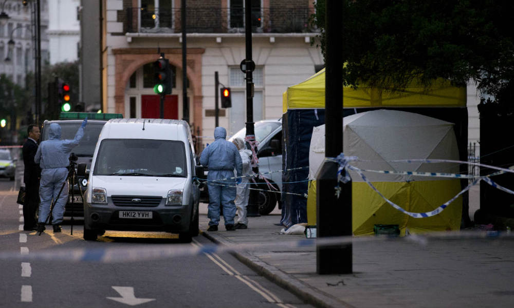 Police forensic officers work in Russell Square in London early on August 4, 2016, after a woman in her 60s was killed during a knife attack. The woman was killed and five people injured in a knife attack in central London late on August 3 which police said they are investigating for possible terrorist links.