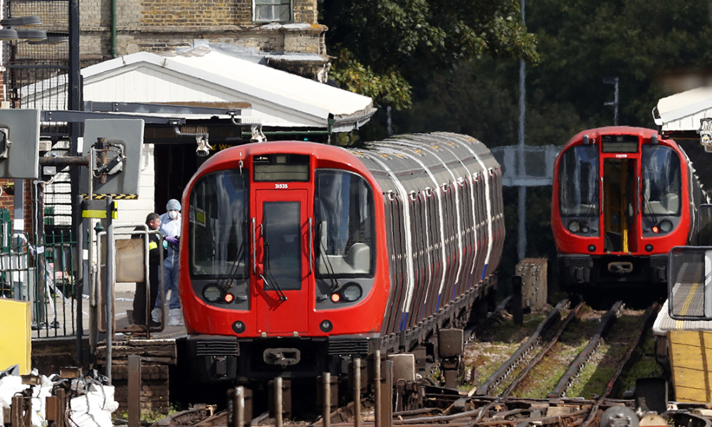 Police forensics officers works alongside an underground tube train at a platform at Parsons Green underground tube station in west London on September 15, 2017, following an incident on an underground tube carriage at the station.