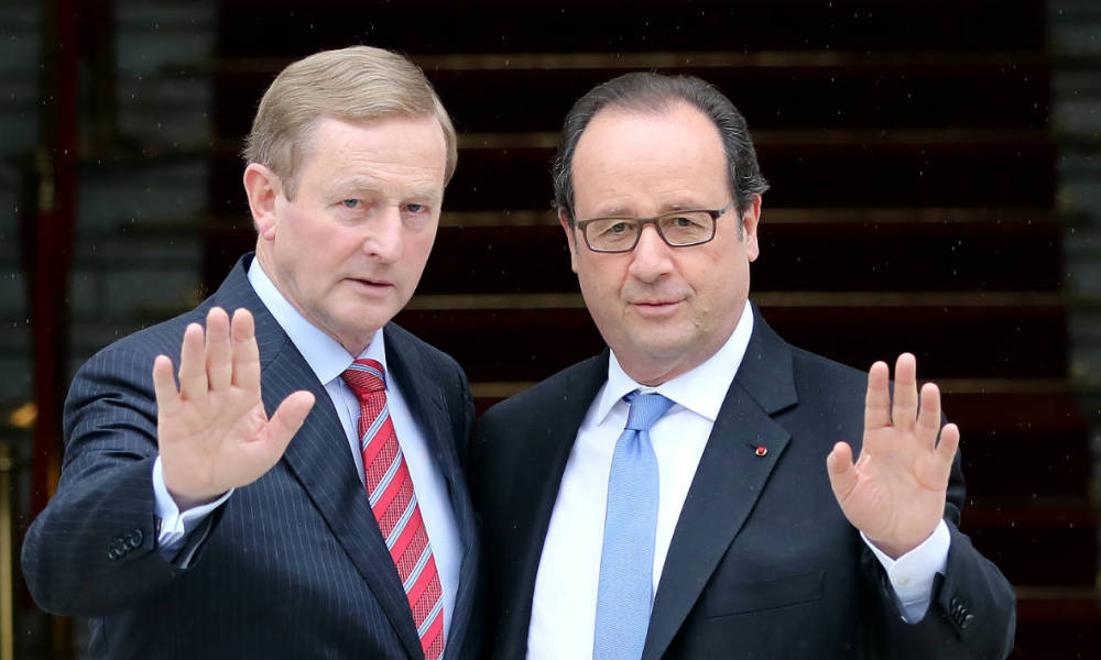 Ireland's Prime Minister Enda Kenny (L) greets French President Francois Hollande at Goverment buildings in Dublin, Ireland, on July 21, 2016.
