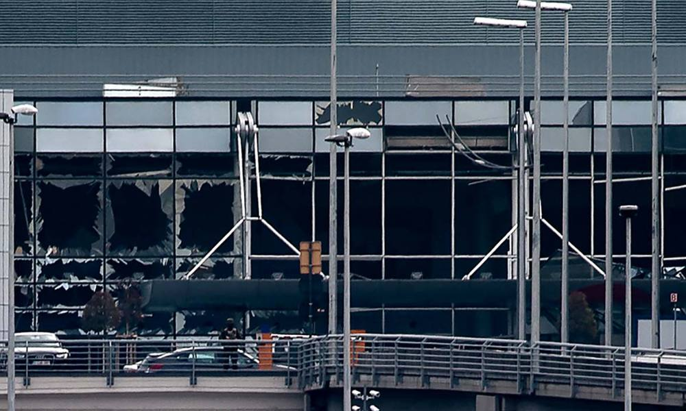 This view taken on March 22, 2016 shows the broken glasses at Brussels Airport in Zaventem after a two explosions targeted the main hall. A string of explosions rocked Brussels airport and a city metro station today, killing at least 13 people, according to media reports, as Belgium raised its terror threat to the maximum level.