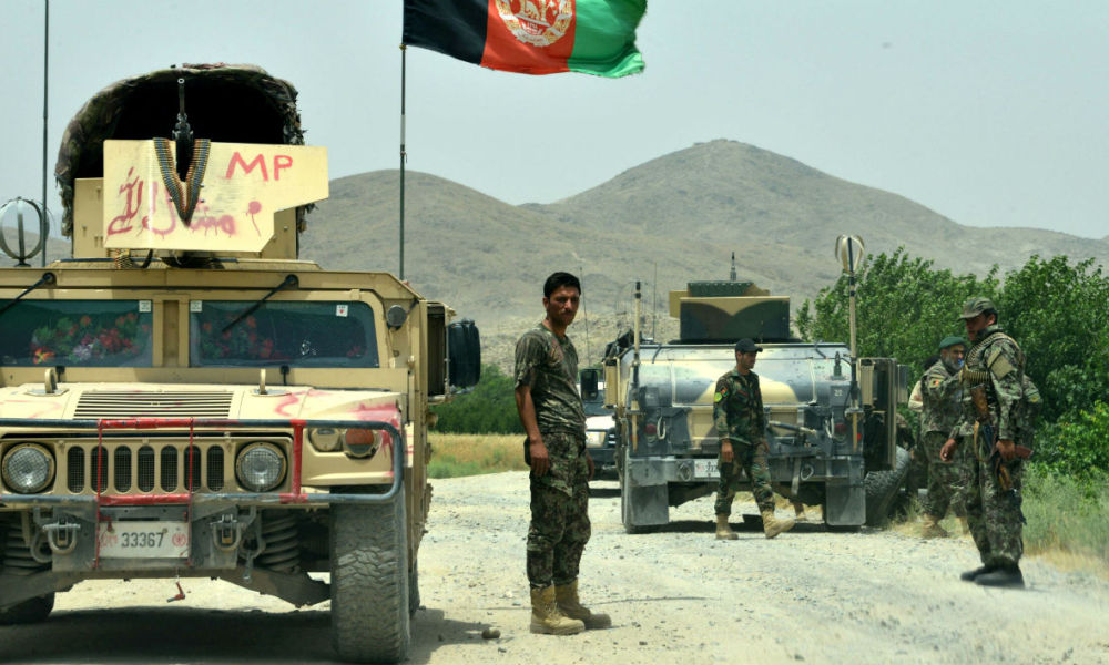 Afghan National Army (ANA) soldiers patrol the Shah Wali Kot district of Kandahar province on May 23, 2017. At least 10 Afghan soldiers were killed when militants attacked their army base in the southern province of Kandahar, the defence ministry said May 23, in the latest attack on Western-backed forces. JAVED TANVEER / AFP