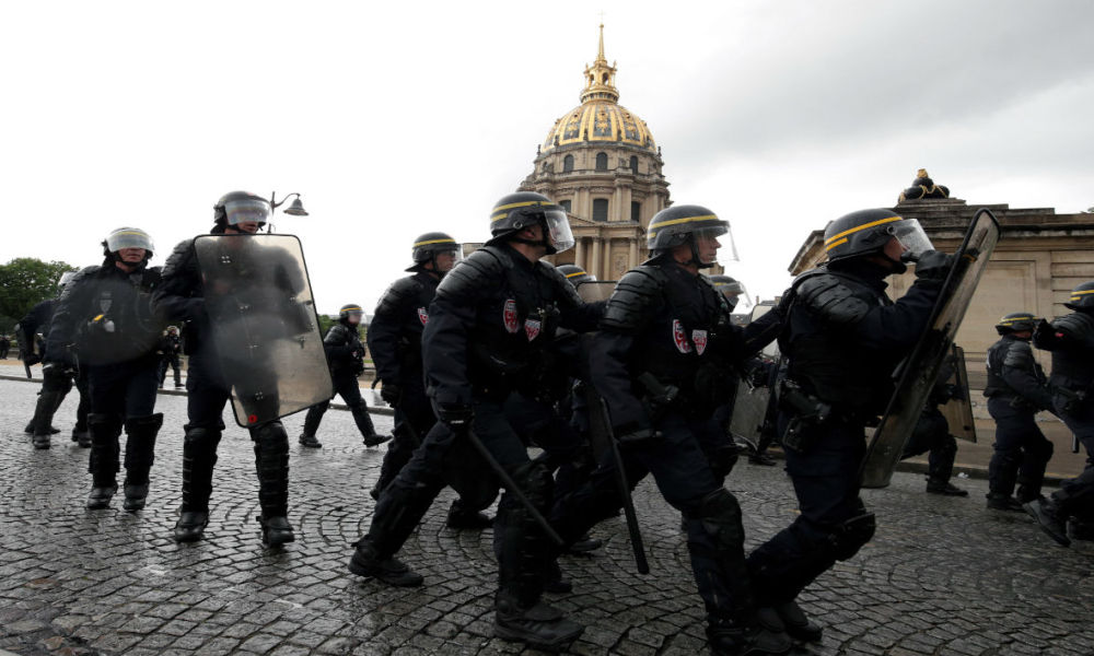 French riot police (CRS) clash with demonstrators during a protest against the government's labour reform on May 12, 2016 near the Invalides in Paris.