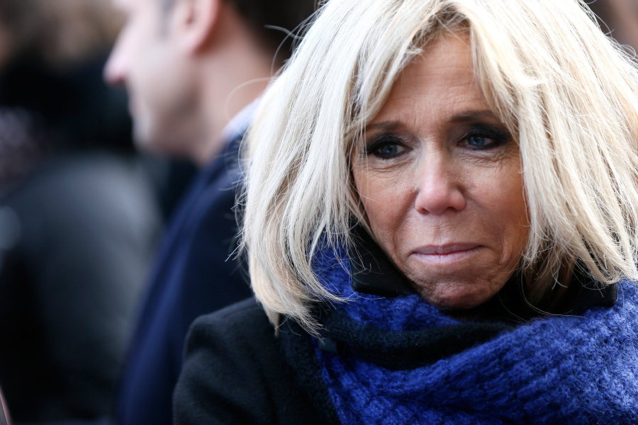 Brigitte Macron, the wife of the French president pays her condolences to relatives of victims near the Bataclan concert venue during a ceremony marking the second anniversary of the Paris attacks of November 2015 in which 130 people were killed, in Paris on November 13, 2017.  Etienne LAURENT / POOL / AFP