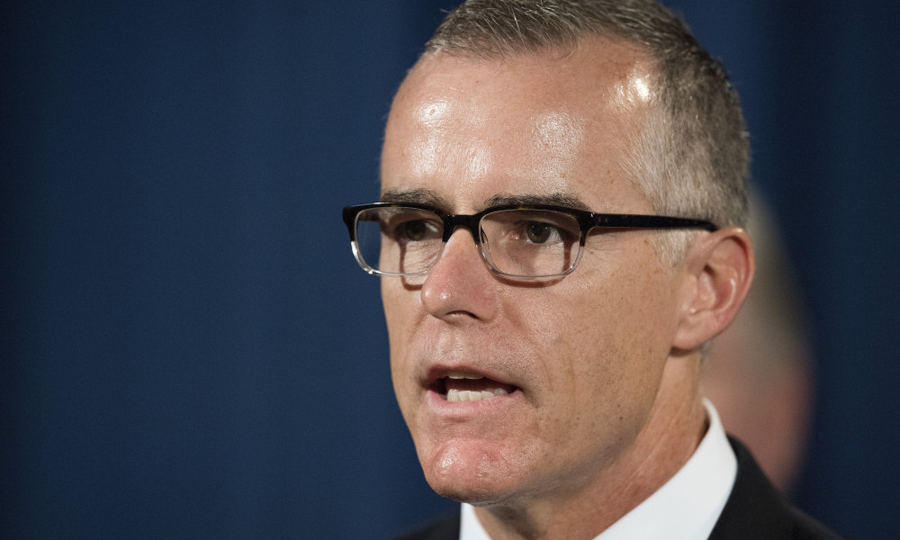 Acting Director of the Federal Bureau of Investigation (FBI) Andrew McCabe speaks during a press conference at the US Department of Justice in Washington, DC, on July 13, 2017.  JIM WATSON / AFP
