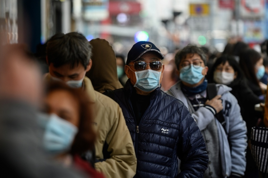 Ressortissants chinois portant des masques. - Philip FONG / AFP