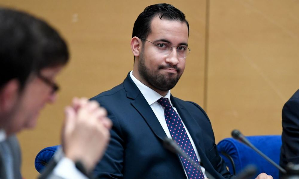 Former Elysee senior security officer Alexandre Benalla looks over prior to the start a Senate committee in Paris on September 19, 2018.