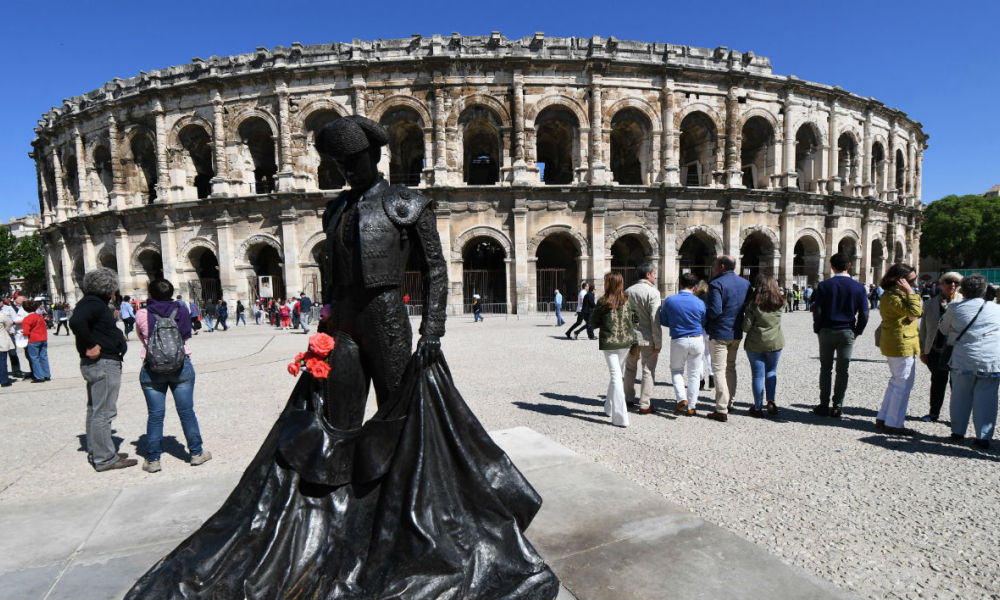 "This photo taken on May 15, 2016 in Nimes, southern France, shows the statue of legendary bullfighter Christian Montcouquiol (""Nimeno II""), outside of the Nimes Pentecost Feria of Bullfighting.  PASCAL GUYOT / AFP"