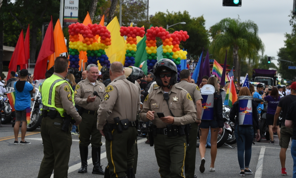 Police stand by to provide security for the 2016 Gay Pride Parade June 12, 20116 in Los Angeles, California. Security for the tightened in the aftermath of the deadly shootings June 12 at the Pulse, a packed gay nightclub in Orlando, Florida. Mark Ralston / AFP