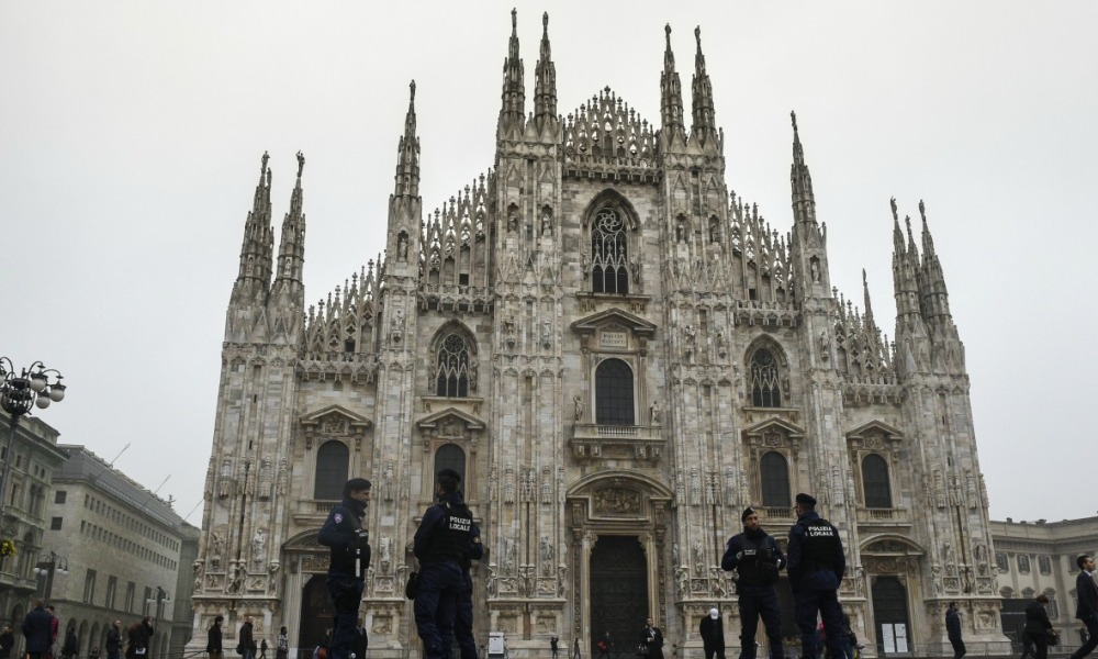 Italian policemen stand at Piazza del Duomo (Milan's cathedral) on November 19, 2015 in Milan. Italy has increased security at its historic monuments in the Vatican, Rome and Milan after a warning from the FBI of possible jihadist attacks, media reports yesterday.