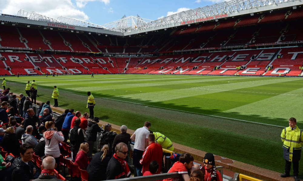The Stretford End (L) and the Sir Alex Ferguson stand (R) are seen empty following an evacuation of both stands