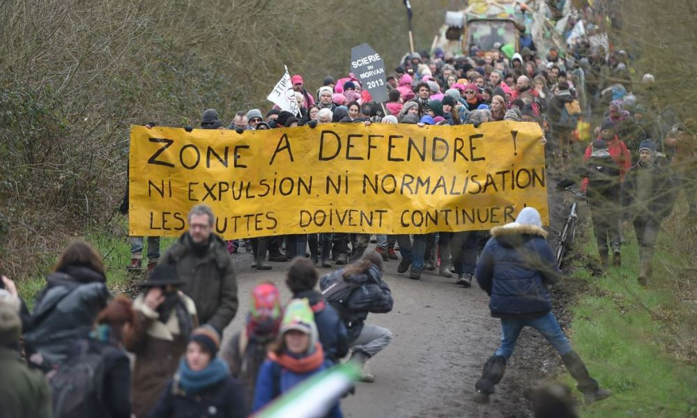 Opponents of the former Notre-Dame-des-Landes (NDDL) airport project march during a rally to celebrate the government's decision to stop the construction of the airport at the ZAD.