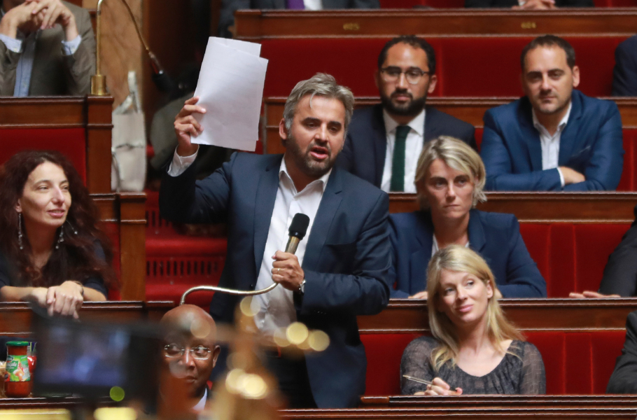 La France Insoumise (LFI) party member of Parliament Alexis Corbiere holds up papers as he speaks during a session of questions to the government at the French National Assembly in Paris on July 26, 2017.