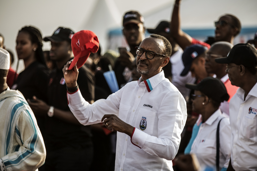 Incumbent Rwandan President Paul Kagame acknowledges the crowd after addressing supporters at the closing rally of the presidential campaign in Kigali, on August 2, 2017. Rwanda holds a presidential election on August 4, 2017. MARCO LONGARI / AFP