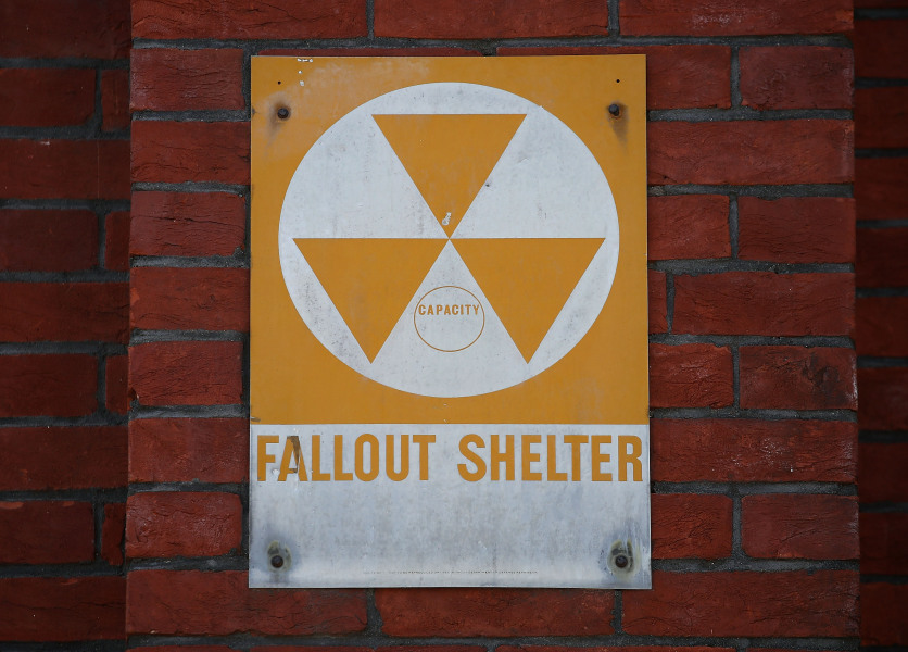 WASHINGTON, DC - AUGUST 09: A fallout shelter sign still hangs near the entrance to the old Bruce Elementary School which is now called the Cesar Chavez Prep Middle School, on August 9, 2017 in Washington, DC.