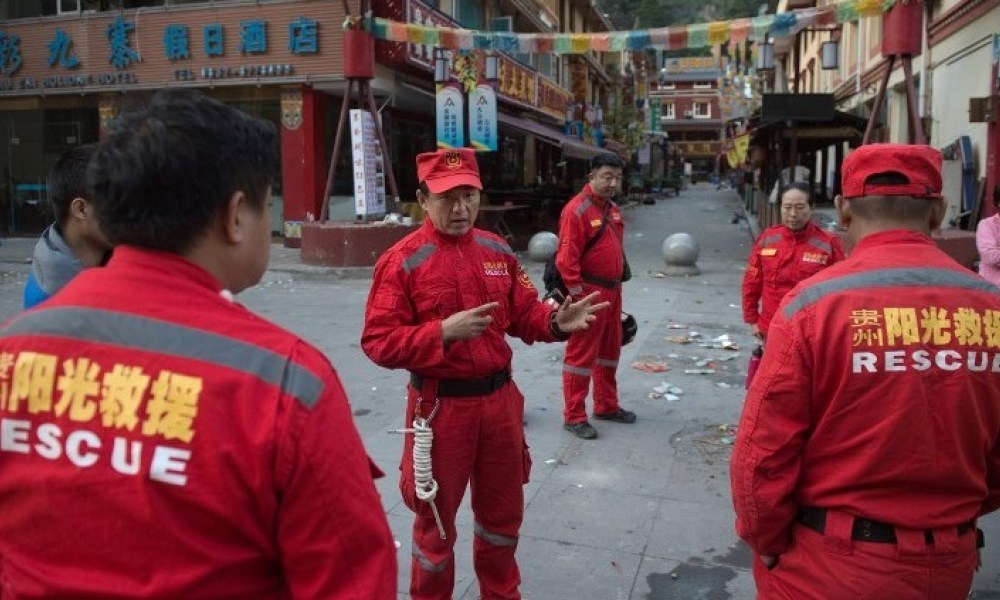 Members of a Chinese rescue team prepare to search for earthquake survivors in Zhangzha in southwest China's Sichuan province on August 10, 2017. The 6.5-magnitude earthquake struck Sichuan province late on August 8, tearing cracks in mountain highways, triggering landslides, damaging buildings and sending panicked residents and tourists fleeing into the open. Nicolas ASFOURI / AFP