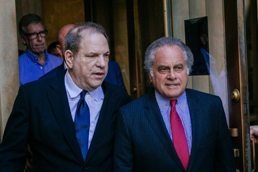 Harvey Weinstein (L) arrives for a court appearance with attorney Benjamin Brafman at Manhattan Criminal Court on July 9, 2018 in New York City. Weinstein, who was previously indicted on charges involving two women, is facing three new felony sex crimes against a third woman. Kevin Hagen/Getty Images/AFP  Kevin Hagen / GETTY IMAGES NORTH AMERICA / AFP