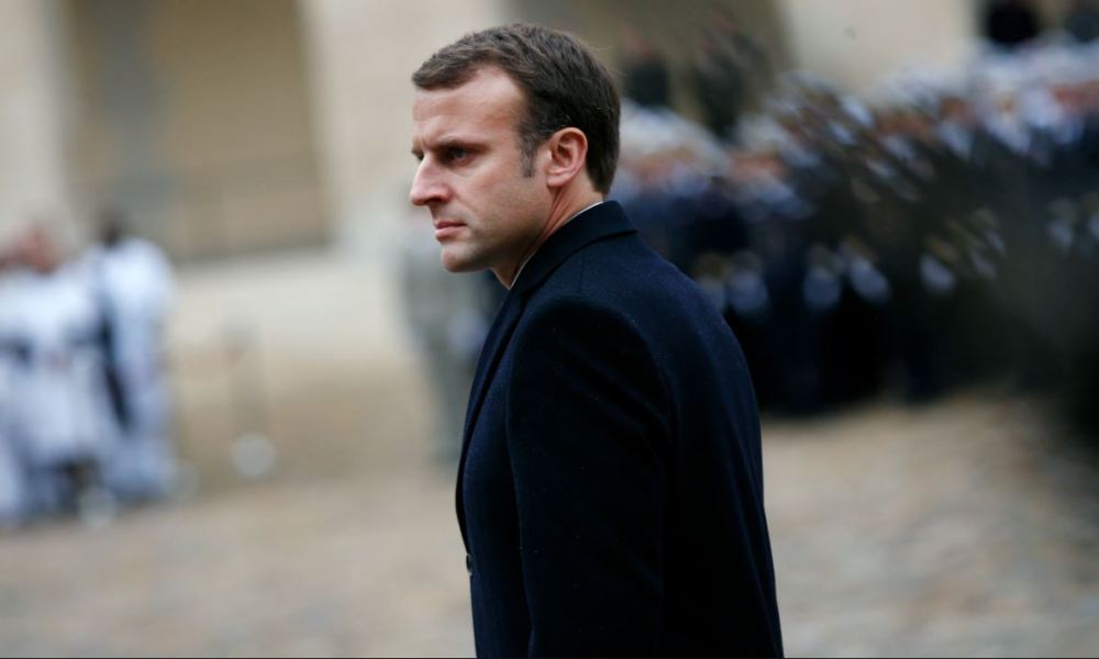 French President Emmanuel Macron reviews French troops during a military ceremony at the Hotel des Invalides on November 27, 2017 in Paris.  Thibault Camus / POOL / AFP