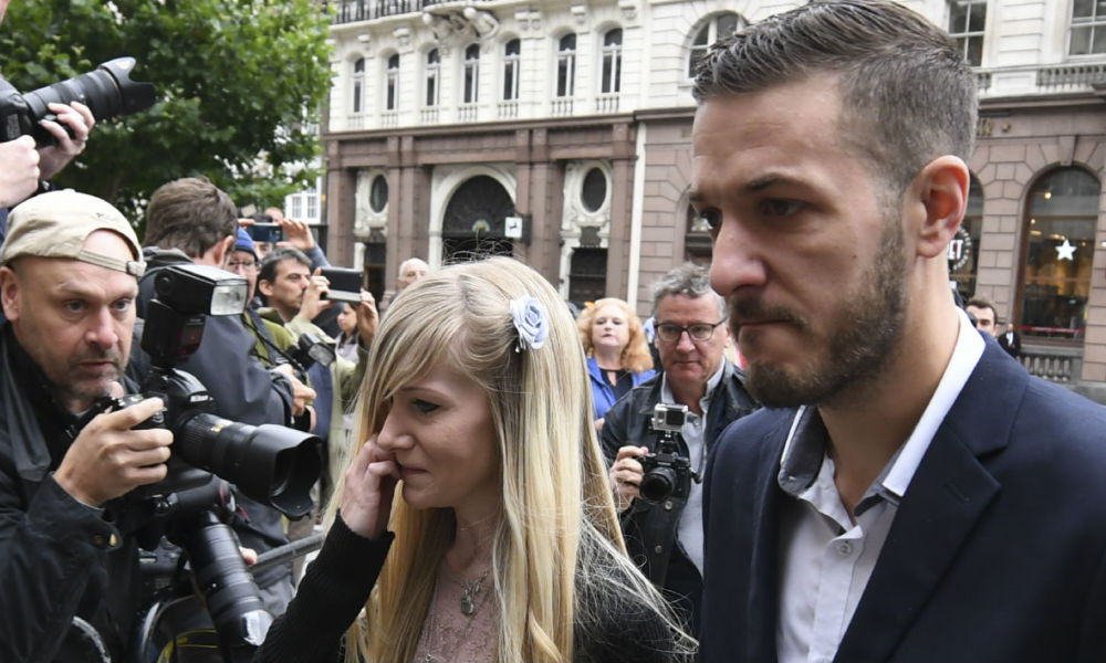 Chris Gard (R) and Connie Yates, the parents of terminally-ill 11-month-old Charlie Gard, arrive at Royal Courts of Justice in London on July 24, 2017. CHRIS J RATCLIFFE / AFP