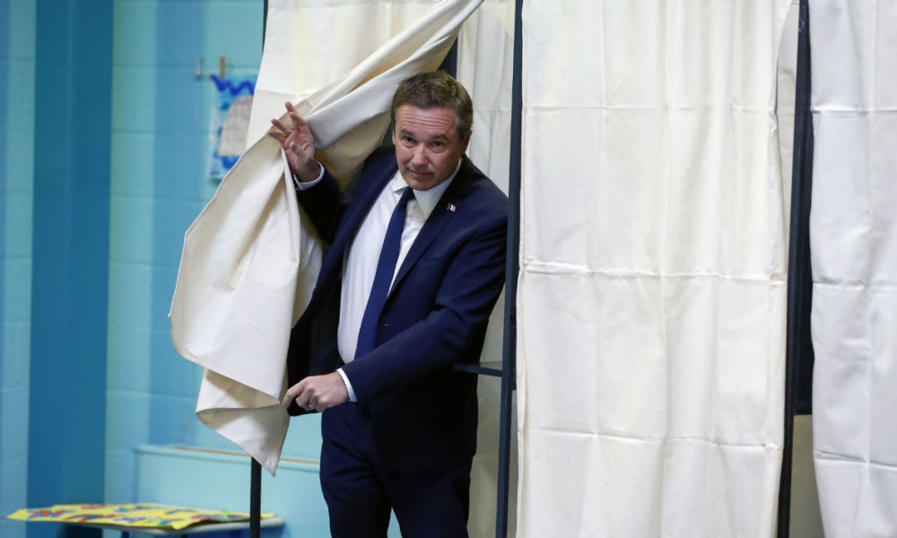 French presidential election candidate for the right-wing Debout la France (DLF) party Nicolas Dupont-Aignan walks out a polling booth after casting his ballot at a polling station in Yerres, Paris' suburb, on April 23, 2017, during the first round of the Presidential election.  Patrick KOVARIK / AFP
