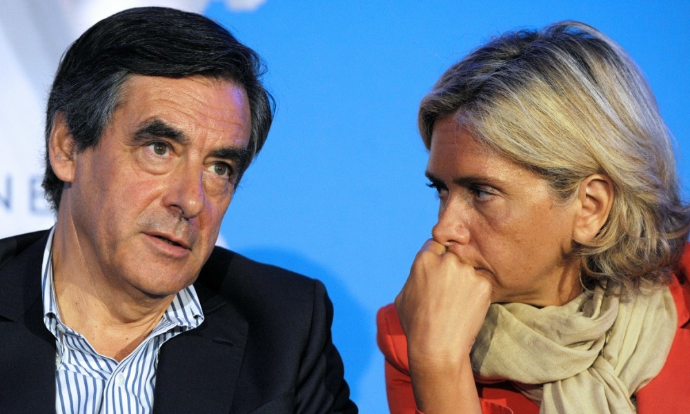Former French Prime Minister Francois Fillon (L), member of a triumvirate leading the French right-wing UMP party and UMP party member and MP Valerie Pecresse attend a meeting with militants on August 27, 2014 in Rouez-en-Champagne, western France. AFP PHOTO / JEAN-FRANCOIS MONIER JEAN-FRANCOIS MONIER / AFP
