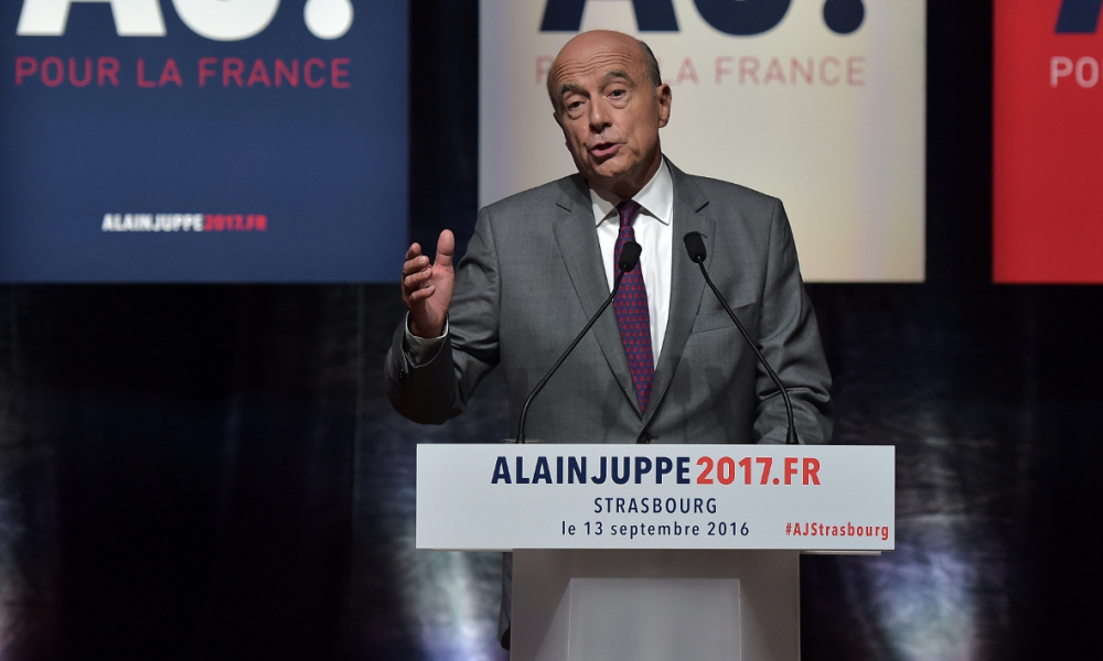 Right-wing Les Republicains (LR) party's candidate for the LR party primary ahead of the 2017 presidential election, Alain Juppe, gestures during a campaign meeting on September 13, 2016 in Strasbourg, eastern France.  PATRICK HERTZOG / AFP