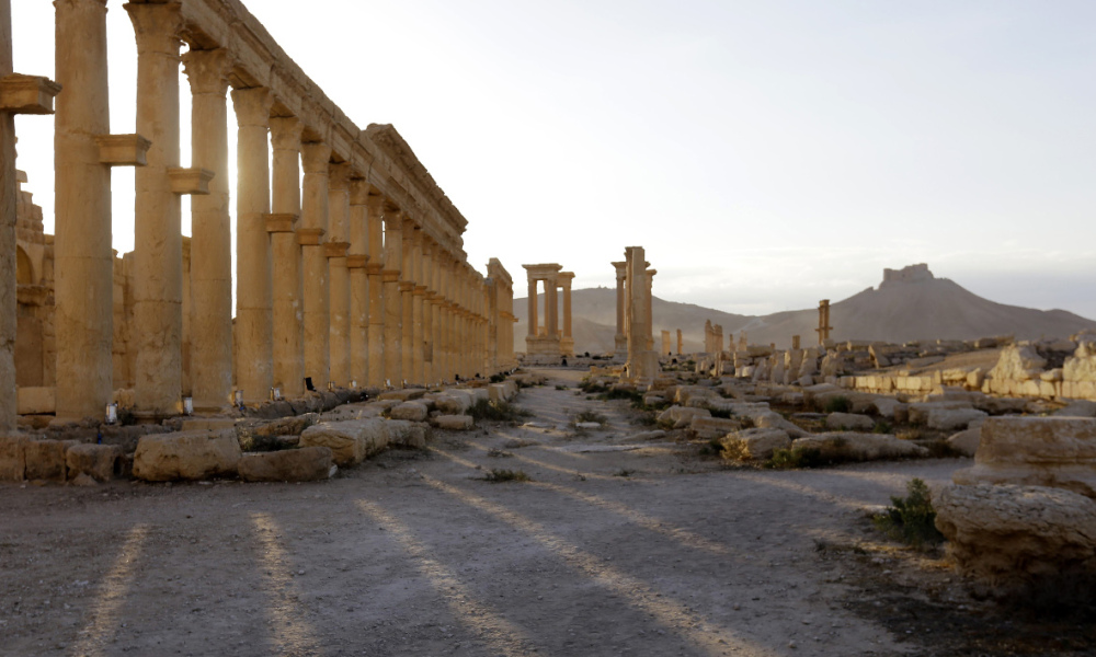 A picture taken on May 6, 2016 shows the remains of the Triumph's Arch, also called the Monumental Arch of Palmyra, in the ancient city of Palmyra in central Syria, following its recapture by regime forces from the Islamic State group fighters.  Syrian troops backed by Russian air strikes and special forces on the ground recaptured UNESCO world heritage site Palmyra from Islamic State (IS) group fighters in March 2016. LOUAI BESHARA / AFP