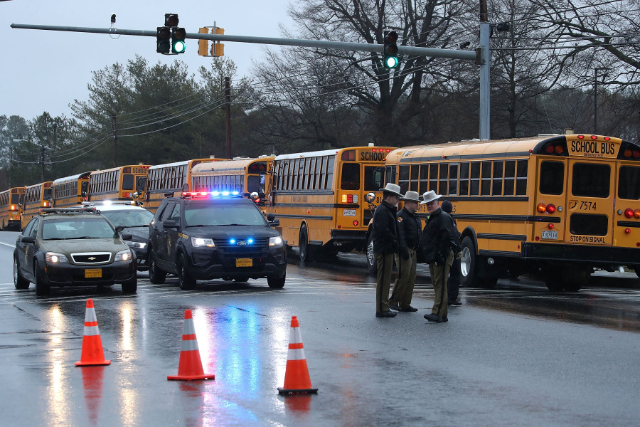 GREAT MILLS, MD - MARCH 20: School buses are lined up in front of Great Mills High School after a shooting on March 20, 2018 in Great Mills, Maryland.