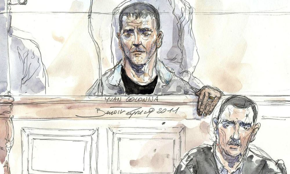 Court sketch made on May 2, 2011 in Paris, shows Yvan Colonna (C) and his lawyer Gilles Simeoni on the opening hearing of his appeal trial for the murder in 1998 of Claude Erignac, France's top state official on the Mediterranean island of Corsica. Colonna, a goat herder and independence activist, was sentenced in the original proceeding, in 2009, to life in prison with 22-year without parole. AFP PHOTO BENOIT PEYRUCQ