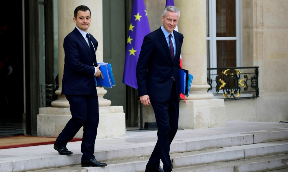 French Economy Minister Bruno Le Maire (R) and Public Action and Accounts Minister Gerald Darmanin (L) leave the Elysee palace after the weekly cabinet meeting, on July 12, 2017 in Paris. Martin BUREAU / AFP