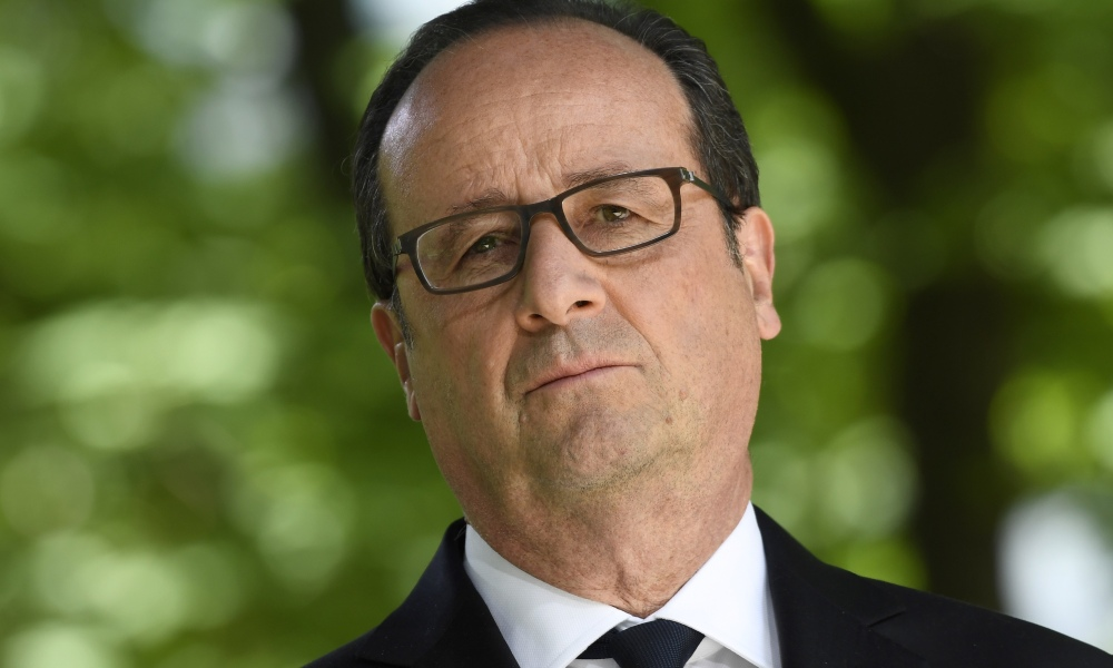 French President Francois Hollande looks on on May 10, 2017 at the Jardins du Luxembourg in Paris during a ceremony to mark the anniversary of the abolition of slavery and to pay tribute to the victims of the slave trade.  Eric FEFERBERG / AFP