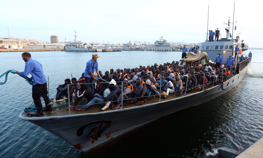 Illegal immigrants, who were rescued by the Libyan coastguard in the Mediterranean off the Libyan coast, arrive at a naval base in the capital Tripoli on May 26, 2017. At least 20 boats carrying thousands of migrants on their way to Italy were spotted off the coast of the western city of Sabratha, the Libyan navy said. MAHMUD TURKIA / AFP