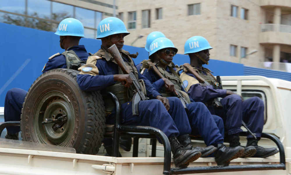 "This photo taken on October 3, 2014 shows the UN Minusca peacekeepers patrolling through the 3rd district of Bangui, following deadly clashes between armed groups in the Central African town of Bambari that have left at least 25 dead, and increasing security on the eve of the Muslim feast of Eid al-Adha. The region remains highly restive due to splits within the Seleka ""between a branch that is more and more radicalised and another which is more open to dialogue to exit the crisis,"" said Colonel Gilles Jaron of the French peacekeeping forces. AFP PHOTO / PACOME PABANDJI"