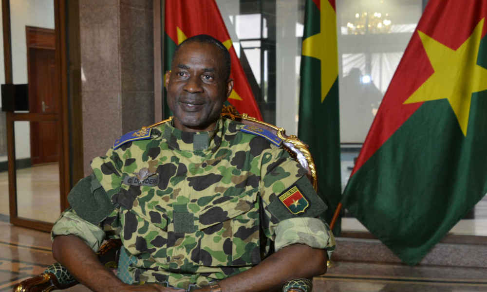General Gilbert Diendere sits at the presidential palace in Ouagadougou, on September 17, 2015 after Burkina Faso's presidential guard declared a coup, a day after seizing the interim president and senior government members, as the country geared up for its first elections since the overthrow of longtime leader Blaise Compaore. Diendere, Compaore's former chief of staff, was appointed head of a governing council, which announced a nighttime curfew and shut down the borders. AFP PHOTO / AHMED OUOBA