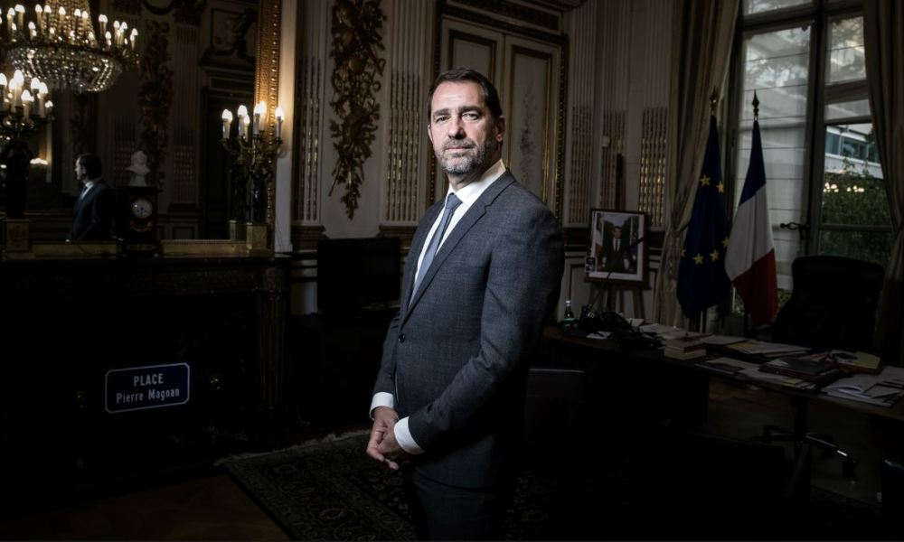(FILES) In this file photo taken on November 13, 2017 French Junior Minister for the Relations with Parliament and Government Spokesperson Christophe Castaner poses during a photo session in his office, in Paris. Castaner has been appointed on October 16, 2018 new French Interior minister, in French cabinet reshuffle. JOEL SAGET / AFP