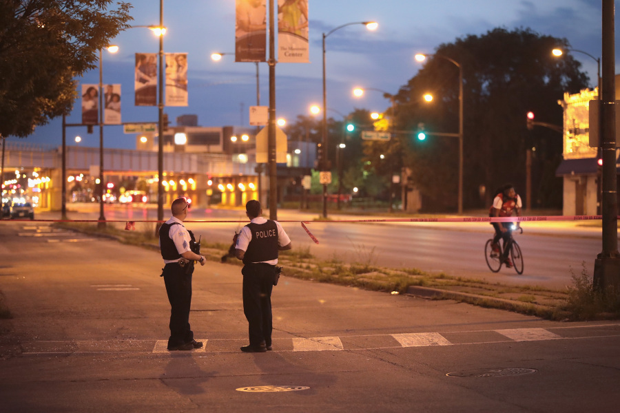 CHICAGO, IL - JULY 02: Police secure the crime scene as they search for evidence after three people were shot in the Lawndale neighborhood on July 2, 2017 in Chicago, Illinois. SCOTT OLSON / GETTY IMAGES NORTH AMERICA / AFP