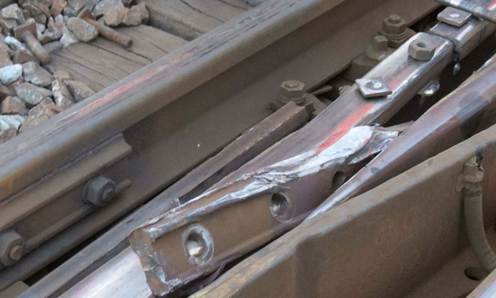 A handout picture released by the France's national railway company SNCF on July 14, 2013 shows the defective fishplate, a metal bar which joins the ends of two rails, which is the cause of the train accident, at the Bretigny-sur-Orge train station. At least six people were killed and dozens injured on July 12, 2013 after a speeding train split in two and derailed at a station in the southern suburbs of Paris.