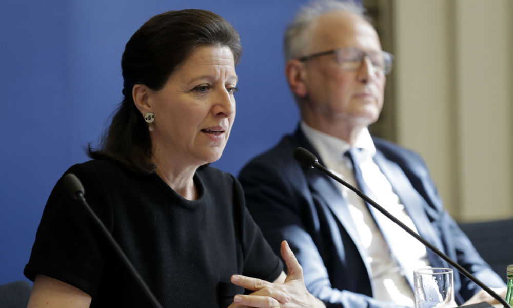 French Minister for Solidarity and Health Agnes Buzyn (L), flanked by doctor and professor in paediatric immunology Alain Fischer (rear R), looks on during a press conference on the future measures concerning the vaccination policy in France, at the Ministry for Solidarity and Health, in Paris, on July 5, 2017.  Thomas Samson / AFP